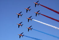 E135 - Patrouille de France, the French Air Force aerobatic team, performing a flyover of the Yorktown Victory Monument in Yorktown, VA to signify the age-old alliance between the United States and France that traces its roots to the Revolutionary War. - by Dean Heald