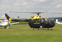 G-PASX @ EGCJ - MBB BO 105DBS-4 Air Ambulance on-call at Sherburn's Fly-in and Veteran Car Meet in 2004. - by Malcolm Clarke