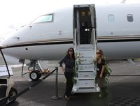 N1RL @ ORL - Two pretty hostesses welcome me aboard a former Indianapolis Speedway CRJ-700
