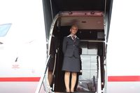 OE-ILI @ ORL - Austrian registered CRJ-200 with pretty blonde hostess from Austria greeting me