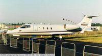 N1055C @ EGLF - Learjet 55C at 1988 Farnborough Air Show - by moxy