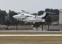 N514AF @ ORL - Embraer Phenom 100