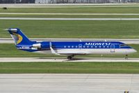 N710BR @ KSAT - Midwest CRJ-200 taxies to its stand