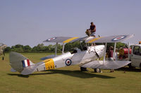 G-AJOA @ EGTH - De Havilland DH-82A Tiger Moth II.  'A top-up before take-off' on De Havilland Day at the Shuttleworth Trust, Old Warden - by Malcolm Clarke