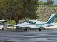 N122EC @ POC - Parked in Transient Parking in the rain - by Helicopterfriend