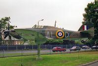 L1710 @ EGKB - Hawker Hurricane (replica).  full-scale replica Hawker Hurricane. Gate-guard outside the RAF Memorial Chapel at the former RAF Biggin Hill. - by Malcolm Clarke