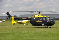 G-PASX @ EGCJ - MBB BO-105DBS-4. Air Ambulance on-call at Sherburn's Fly-in and Veteran Car Meet in 2004. - by Malcolm Clarke
