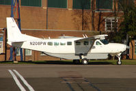 N208PW @ EGTC - Cessna Caravan at Cranfield awaiting taking up marks of G-DLAC