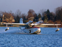 N70AL @ 51MI - Taxiing across the lake - by Isaac Adler