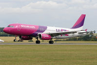 HA-LPL @ EGGW - Touching down on Runway 26. - by MikeP