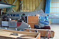 N40P @ CYQF - De Havilland DH.104 Dove 6BA [04361] Red Deer~C 23/07/2009. Seen stored bare metal undergoing restoration Red Deer Regional Canada.