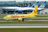 D-AHXI @ EDDM - yellow bird in front of the mostly white and blue SA-planes - by Robbie0102