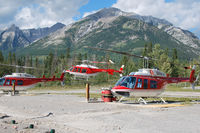 C-GYAA @ CEW9 - C-GYAA between C-GALL and C-GALJ at Alpine Helicopter's Homebase in Canmore - by Tomas Milosch