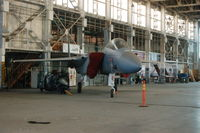 76-0063 - F15A Eagle under restoration in hanger 67 (with the Tomcat) - by jetjockey