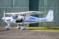 G-JADW @ EGBO - Part of a busy aviation scene at Wolverhampton (Halfpenny Green) Airport on a crisp winters day