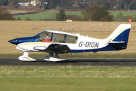 G-DIGN @ EGBO - Part of a busy aviation scene at Wolverhampton (Halfpenny Green) Airport on a crisp winters day