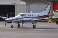N34RF @ EGBJ - Beech 90A visitor to Staverton