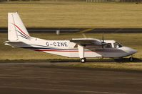 G-CZNE @ EGBJ - Islander made a brief stop at Staverton for fuel