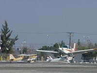 N1195L @ CCB - Landing in front of N6588C and N4187Y - by Helicopterfriend