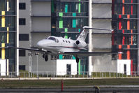 OE-FCB @ EGLC - Austrian Cessna 510 Mustang lands against the distinctive London City Airport background