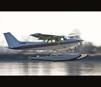 C-GKNH @ CYPK - Doing touch and goes on the Fraser - by Doug R. Matheson