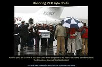N229CK @ PVD - Family members of Marine Pfc. Kyle J. Coutu, of Pawtucket, watch as his casket is taken from a private jet after arriving Wednesday 2/24/2010 at T.F. Green Airport in Warwick. Coutu was killed in combat in Afghanistan. - by The Providence Journal / Bob Breidenbach