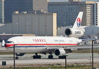 B-2171 @ KLAX - China Eastern Cargo Mcdonnell Douglas MD-11, touching down 25L KLAX. - by Mark Kalfas