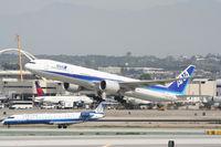 JA732A @ KLAX - ANA Boeing 777-381 (ER), JA732A, ANA5 departing to RJAA (Narita Int'l) 25R KLAX. - by Mark Kalfas