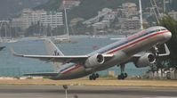 N644AA @ TNCM - N642AA departing TNCM runway 28 - by Daniel Jef