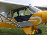 VH-AKD @ YMEL - Piper Cub Special. Entry door. - by red750