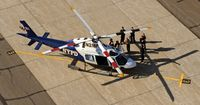 N316PD @ FRG - Boy Scouts checking out the Helo on the Main Terminal Ramp