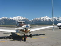 N4549K @ KJAC - Jackson Hole Grand Tetons Back Drop - by Bart Bartelsman