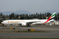 A6-EGA @ KPAE - KPAE Latest 777 frame built on tow from the paint shop to the compass rose