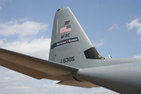 97-5305 @ KIAH - The tail of a Hurricane Hunter soaks up the warm sun. - by Darryl Roach