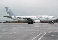 CS-TKI @ EGGP - White Airlines - by vickersfour