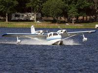 N9508U - Landing on Lake Agnes - by JOE OSCIAK