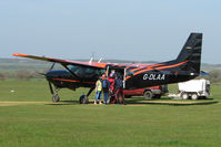 G-DLAA @ EGSP - Cessna Caravan loads up with skydivers on a pleasant day at Peterborough Sibson