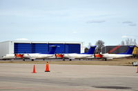 LN-RDP @ ESKN - SAS Commuter Dash 8 400s at Nyköping Skavsta airport in Sweden. These are LN-RDP (in front), LN-RDT and LN-RDA, which are in storage after being taken out of service by SAS after a series of main landing gear collapses. - by Henk van Capelle
