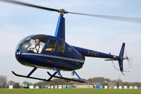 G-EVEV @ EGBR - Robinson R44 Raven at Breighton Airfield, UK in 2010. - by Malcolm Clarke