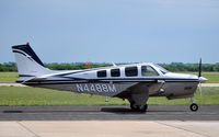 N4488M @ KTPL - Beechcraft Bonanza taxiing by at Central Texas airshow '10. - by TorchBCT
