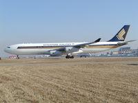 9V-SJN @ ZBAA - Holding short runway - by ghans
