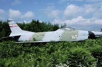 14307 @ LJLJ - When the Yugoslav civil war broke out, the Serbians left Brnik air base, but left behind this F-86D. In 1998 it was still in place, although nature tried hard to get hold of this storage area. - by Joop de Groot