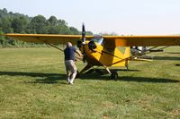 N6234H @ OH36 - Hand-prop start for Young Eagle rides at the Zanesville Riverside EAA breakfast fly-in. - by Bob Simmermon