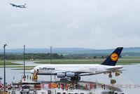 D-AIMA @ VIE - Size comparison: Lufthansa A380 (D-AIMA) with Austrian A320 (OE-LBR) departing. - by Chris J