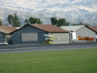 N815AH @ SZP - 2006 Air Creation USA TANARG, Rotax 912ULS 80 Hp tri-blade pusher prop, two-place weight-shift control Experimental class Light Sport aircraft, taxi to hangar. Snow in the Topa Topa mountains in background. - by Doug Robertson