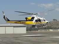 N110LA @ POC - Settling down on LACO Fire Helipad - by Helicopterfriend
