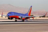 N730SW @ LAS - Southwest Airlines N730SW (FLT SWA1543) from Phoenix/Sky Harbor Int'l (KPHX) landing RWY 25L. - by Dean Heald