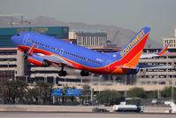 N233LV @ LAS - Southwest Airlines N233LV (FLT SWA738) departing RWY 25R enroute to Los Angeles Int'l (KLAX). - by Dean Heald
