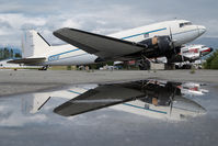 N305SF @ PAAQ - Bush Air Cargo DC3 - reflection