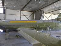 61-2490 @ IGM - JetStar undergoing exterior restoration at Straube's in Kingman, AZ - by Russ Whitlock